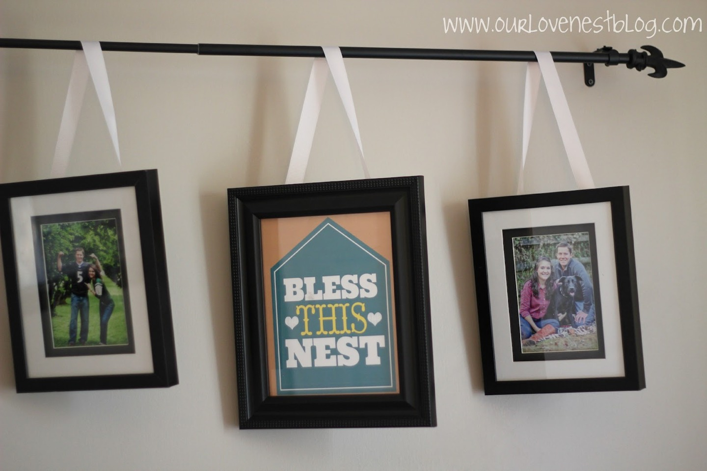 Hang Picture Frames With Ribbon off A Curtain Pole For A