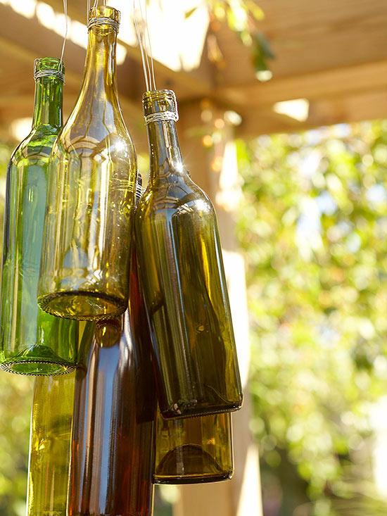 Wine bottle wind chimes outdoor decorating trusper for Empty bottle decoration ideas
