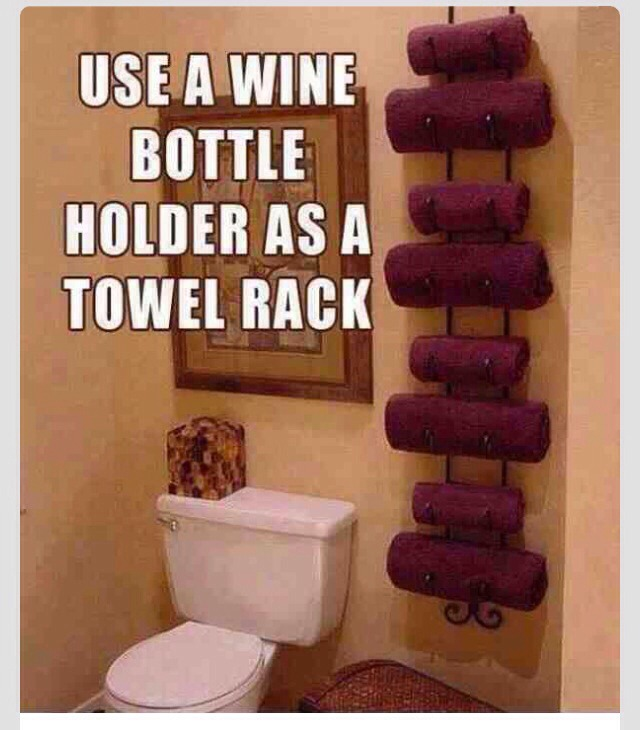 GREAT IDEA!!(: Use A Wine Bottle Holder As A Towel Rack. (: