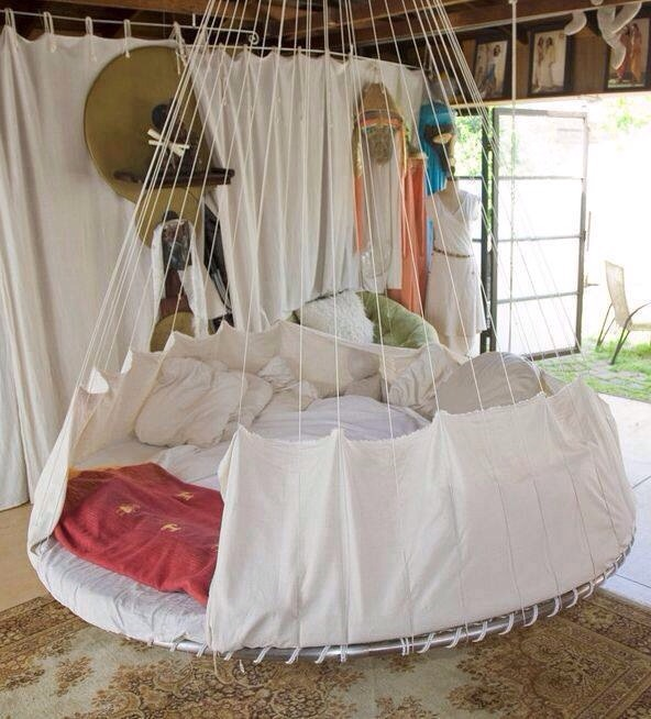 Hanging trampoline bed ideas trusper for Round hanging porch bed